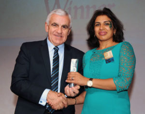 Meghana picks up her award for her excellent work as a diversity and inclusivity champion