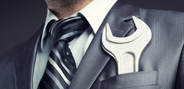 businessman with spanner in pocket