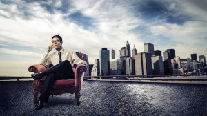 businessman in chair with city