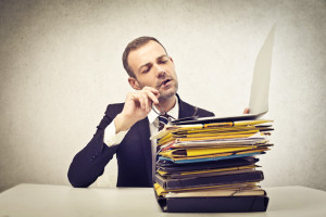 businessman with pile of folders