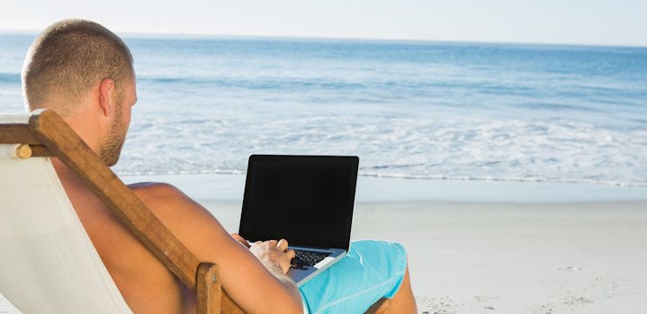 man on holiday with laptop